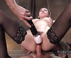 Big-titted slave gets threesome in dungeon